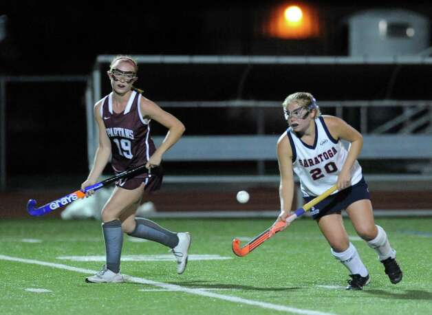 Saratoga's Susan Winters brings the ball up field followed by Burnt Hills Courtney Kruzikus during their high school field hockey game on Wednesday Oct. 7, 2015 in Schuylerville, N.Y.  (Michael P. Farrell/Times Union) Photo: Michael P. Farrell / 10033660A