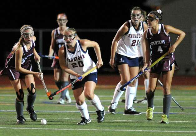 Saratoga's Susan Winters brings the ball up field during their high school field hockey game against Burnt Hills on Wednesday Oct. 7, 2015 in Schuylerville, N.Y.  (Michael P. Farrell/Times Union) Photo: Michael P. Farrell / 10033660A