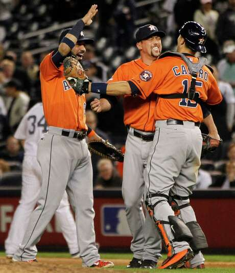 Houston Astros closer Luke Gregerson, center, celebrates the Astros 3-0 win over the New York Yankees with first baseman Marwin Gonzalez and catcher Jason Castro in the American League Wild Card game at Yankee Stadium on Tuesday, Oct. 6, 2015, in New York. ( Karen Warren / Houston Chronicle ) Photo: Karen Warren, Staff / © 2015 Houston Chronicle