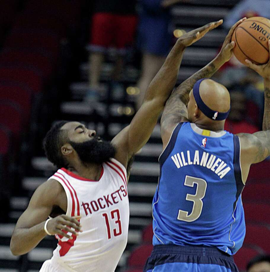 Houston Rockets guard James Harden left, and Dallas Mavericks forward Charlie Villanueva right, during first half NBA preseason game action at the Toyota Center Wednesday, Oct. 7, 2015, in Houston.  ( James Nielsen / Houston Chronicle ) Photo: James Nielsen, Staff / © 2015  Houston Chronicle
