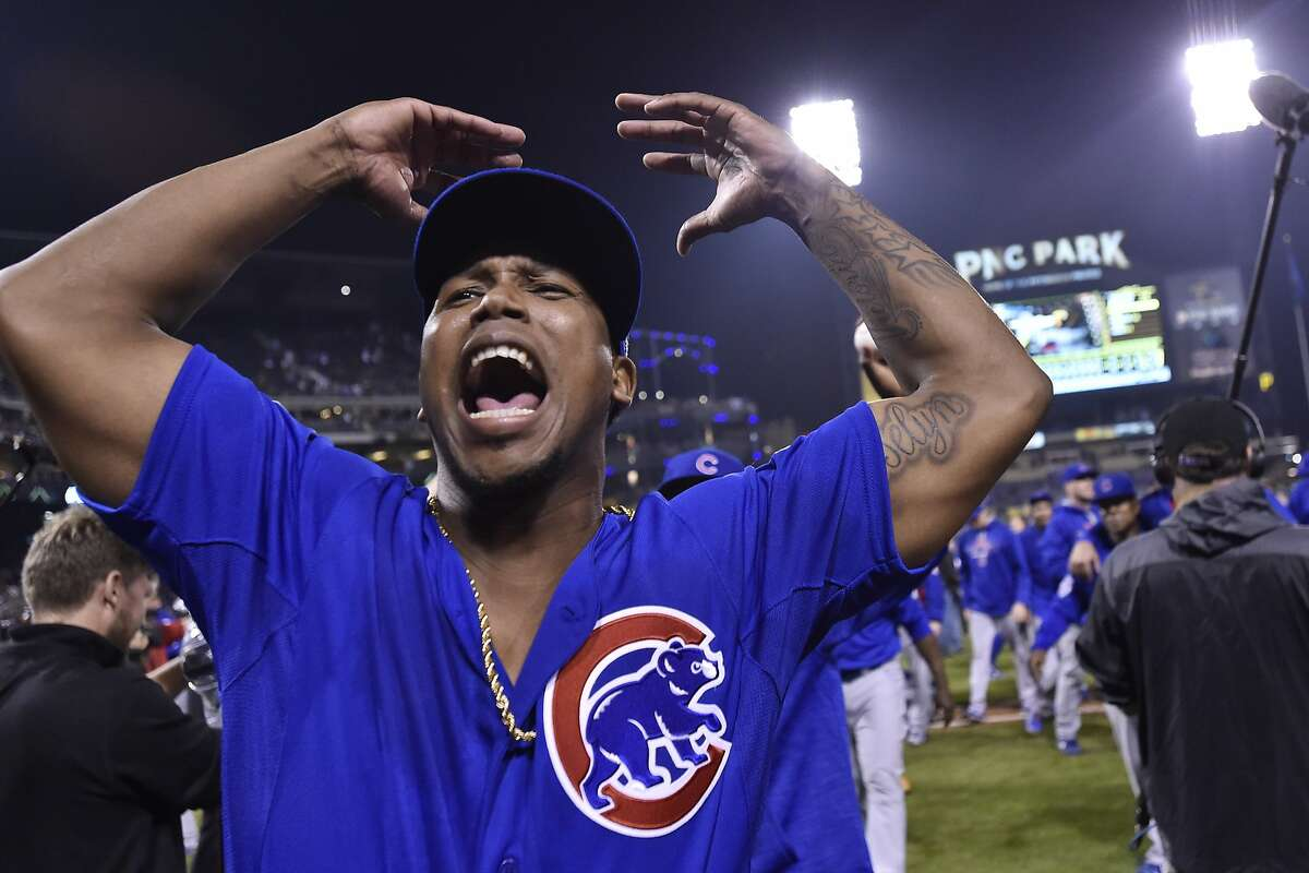 Chicago Cubs' Pedro Strop celebrates after defeating the Pittsburgh Pirates, 4-0, to win the National League wild card baseball game Wednesday, Oct. 7, 2015, in Pittsburgh. The Cubs advance to play the St. Louis Cardinals in the National League division series. (AP Photo/Don Wright)
