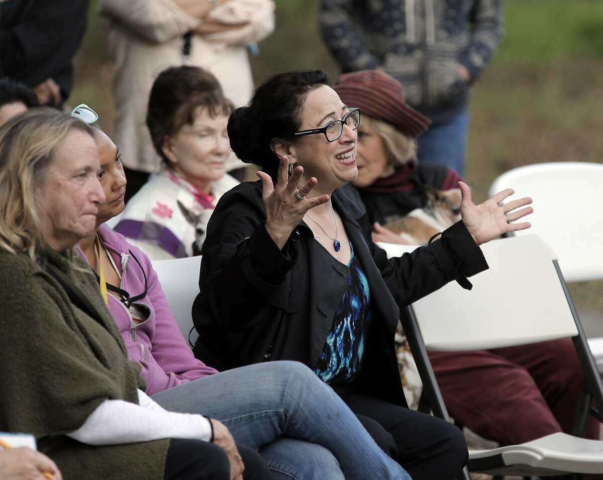 Sonya Rama tries to make a point about an encounter she had with a coyote during a coyote hazing teaching event presented by Project Coyote at Pine Lake Park in San Francisco, Calif., on Wednesday, October 7, 2015. Neighbors and local dog walkers are looking for ways to coexist with coyotes that might threaten dogs in the area.