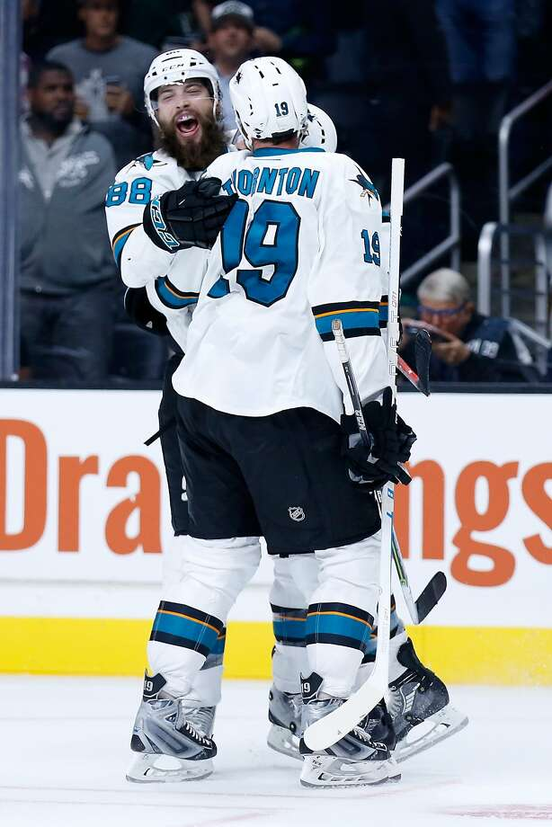 San Jose's Brent Burns (left) and Joe Thornton celebrate a first-period goal. Photo: Sean M. Haffey, Getty Images