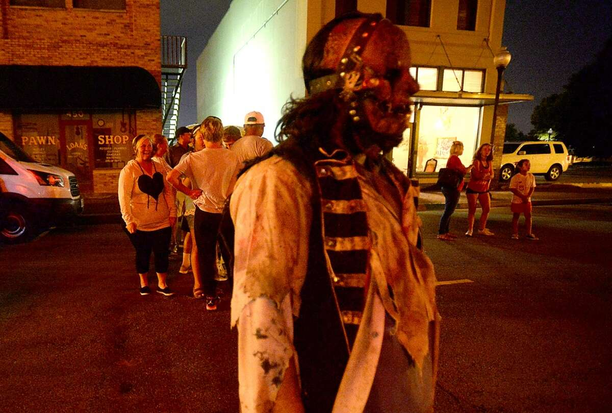 Creey characters roam Orleans Street on the opening weekend of the Haunted Hotel in downtown Beaumont. Fright Night runs every Friday through Sunday opening at 7:13 p.m., and nightly Oct. 27 - 31. The event offers over 20 rooms filled with frightful scenes and creepy characters. Photo taken Saturday, September 26, 2015 Photo by Kim Brent