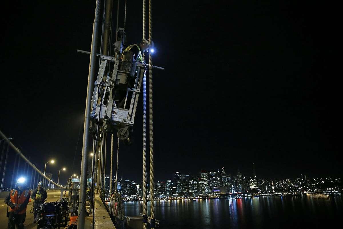Steve Sand works on during installing The Bay Lights on the Bay Bridge in San Francisco, Calif., on Wednesday, October 7, 2015.