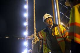 Zoon Engineering Senior Construction Manager Saeed Shahmirzai, explains the installation of The Bay Lights on the Bay Bridge in San Francisco, Calif., on Wednesday, October 7, 2015.