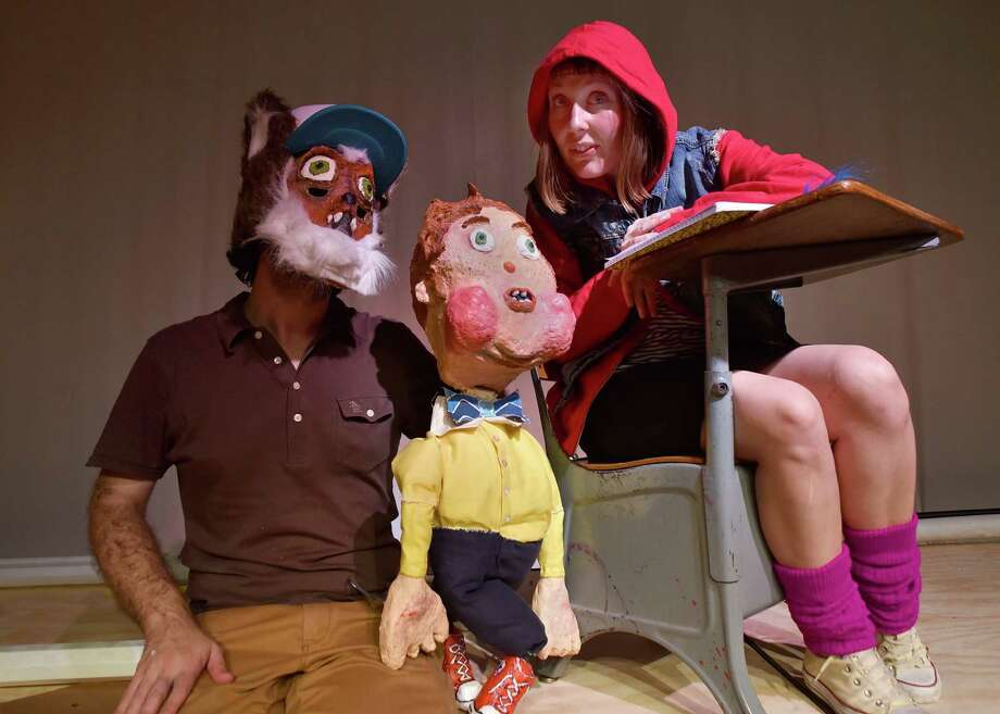 "Zach Dorn (from left) and Murphi Cook, who comprise Miniature Curiosa, created and star in ""Red,"" a take on the story of Little Red Riding Hood that is being staged at Magik Theatre. Photo: Courtesy R.C. French"