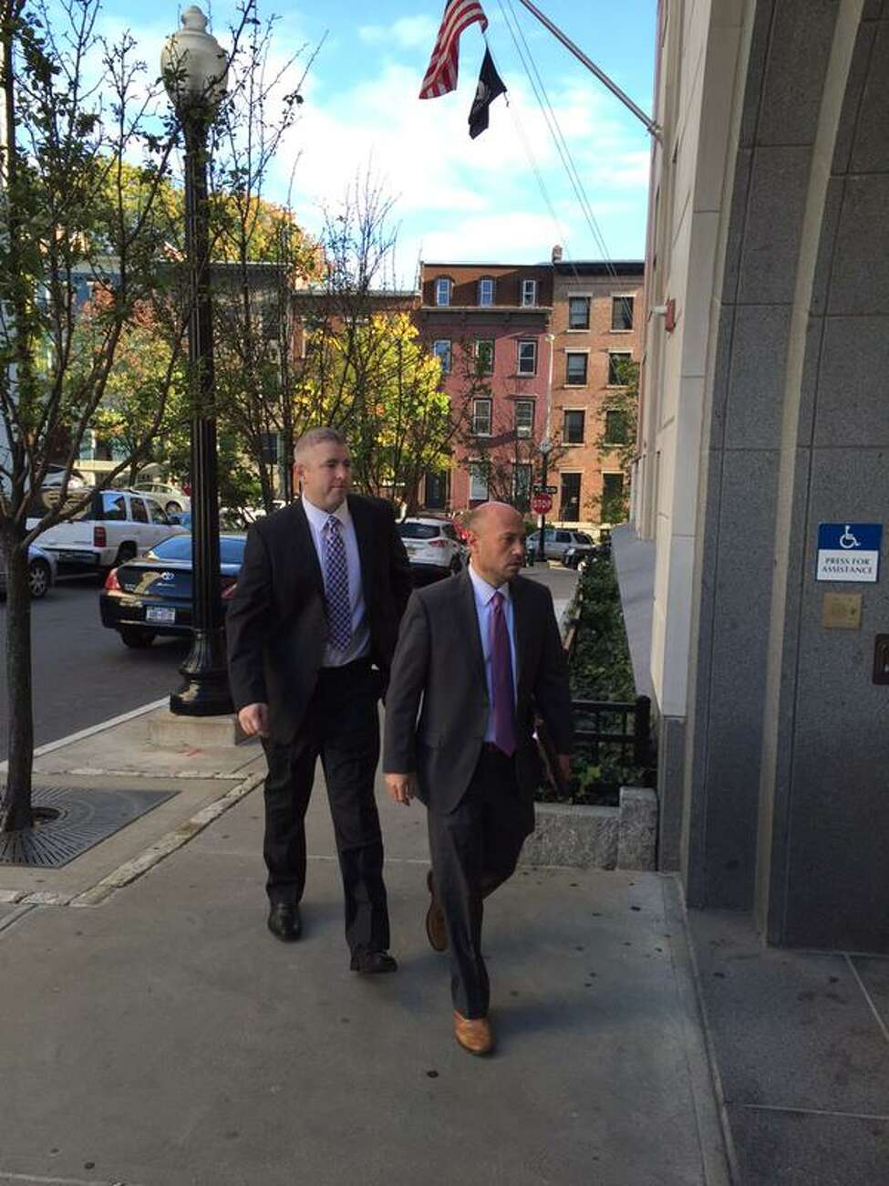 Watervliet Police Officer Joshua Spratt enters Albany County Court with his attorney Andrew Safranko on Thursday, Oct. 8, 2015, in Albany, NY. (Robert Gavin/Times Union)
