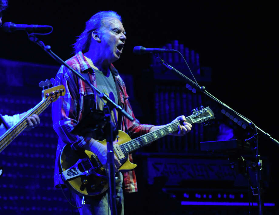 Neil Young performs in concert at the Webster Bank Arena in Bridgeport, Conn. on Tuesday December 4, 2012. Photo: Christian Abraham / Christian Abraham / Connecticut Post