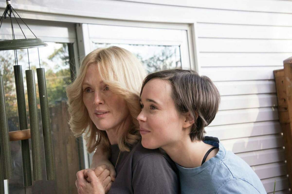 Julianne Moore, left, plays a dying woman trying to ensure her partner, played by Ellen Page, receives her pension benefits in the based-on-a-true-story