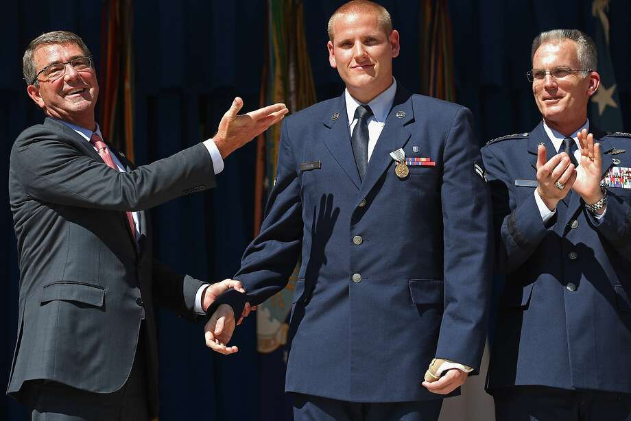U.S. Air Force Airman 1st Class Spencer Stone  (center) is congratulated by U.S. Defense Secretary Ashton Carter (left) and Vice Chairman of the Joint Chiefs of Staff Gen. Paul Selva during an awards ceremony for Stone and two other men who helped stop a gunman on a Paris-bound train last month at the Pentagon September 17, 2015 in Arlington, Virginia. Stone received the Airman's Medal and the Purple Heart medal, Army Specialist Alek Skarlatos received the Soldier's Medal and Anthony Sadler received the Defense Department Medal for Valor. The three men helped overpower gunman Ayoub El-Khazzani, 25, after he opened fire on a Thalys train traveling from Amsterdam to Paris on August 21.  Photo: Chip Somodevilla