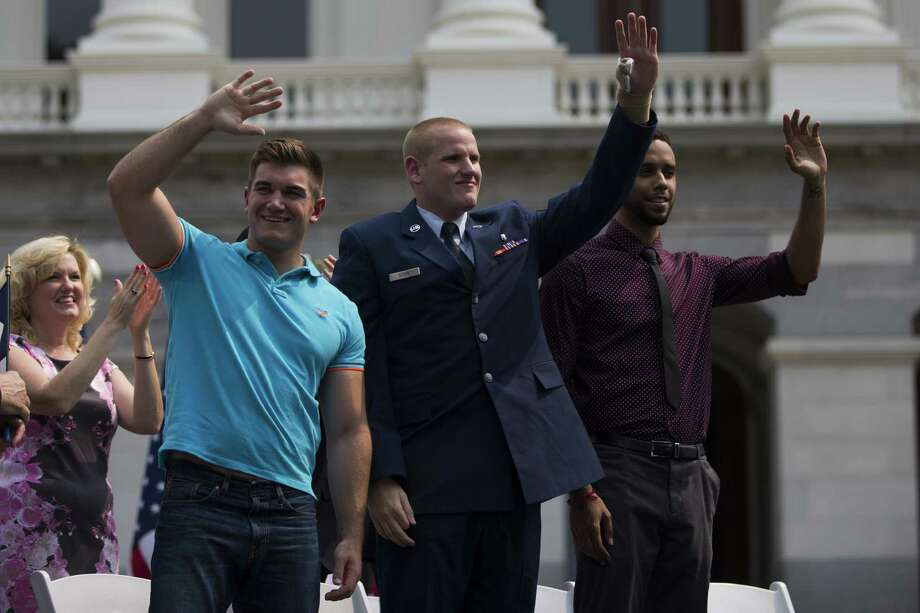 US Airman Spencer Stone, who helped to stop a terror attack on a train in France in August, has been stabbed several times, according to reports. (L-R) Alek Skarlatos, Spencer Stone and Anthony Sadler wave to the crowd during a parade honoring their August 21 actions in overpowering a gunman on a Paris-bound train on September 11, 2015 in Sacramento, California. Thousands lined the street along Capitol Mall to celebrate their hometown heroes. (Photo by Stephen Lam/ Getty Images) Photo: Stephen Lam / 2015 Getty Images