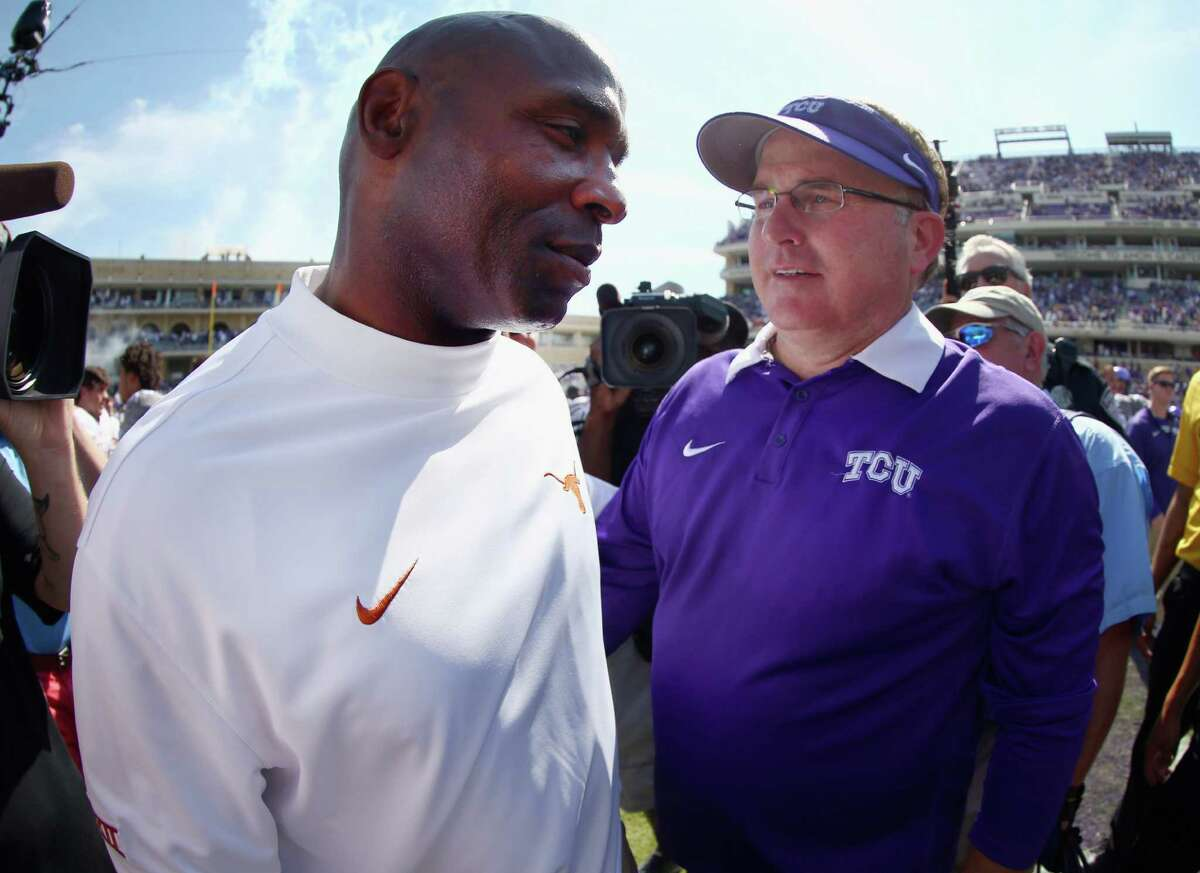 FORT WORTH, TX - OCTOBER 03: Head coach Gary Patterson of the TCU Horned Frogs greets head coach Charlie Strong of the Texas Longhorns at midfield after the Horned Frogs beat the Texas Longhorns 50-7 at Amon G. Carter Stadium on October 3, 2015 in Fort Worth, Texas. (Photo by Tom Pennington/Getty Images)