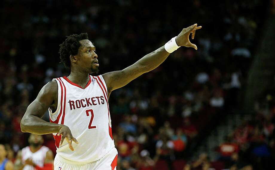 Houston Rockets guard Patrick Beverley reacts after scoring a shot against the Dallas Mavericks during second half NBA preseason game action at the Toyota Center Wednesday, Oct. 7, 2015, in Houston.  ( James Nielsen / Houston Chronicle ) Photo: James Nielsen, Staff / © 2015  Houston Chronicle