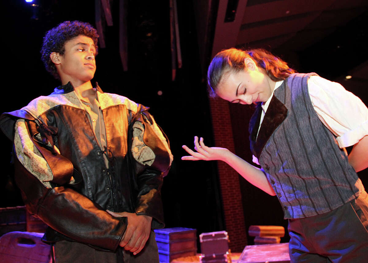 Disguised as a man, destitute Viola, played by Lauren Bass, right, becomes a page to nobleman Orsino, played by Antonio Lasanta, in Dawson High School's production of