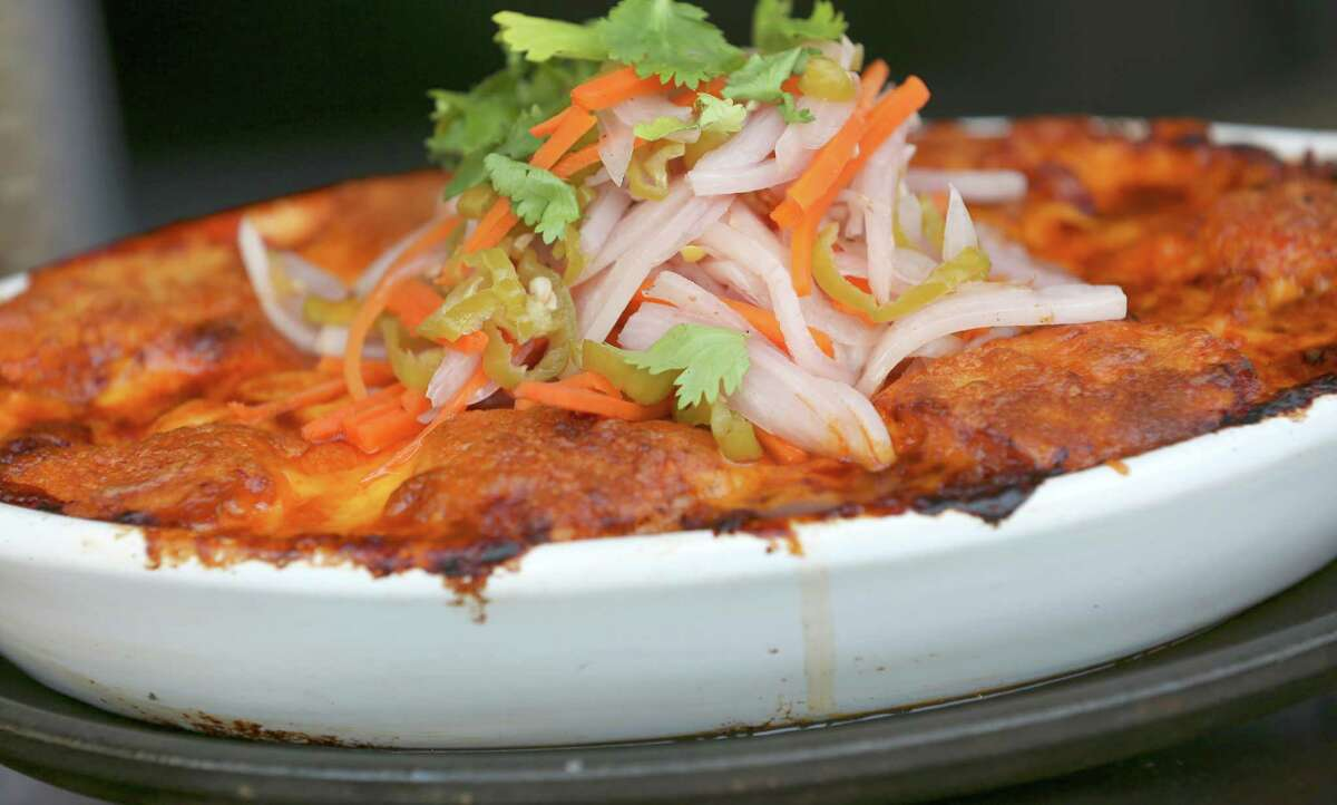Tamale pie, a home cooking classic, includes chicken chili, cornbread rounds and a topping of pickled onions and jalapeños.
