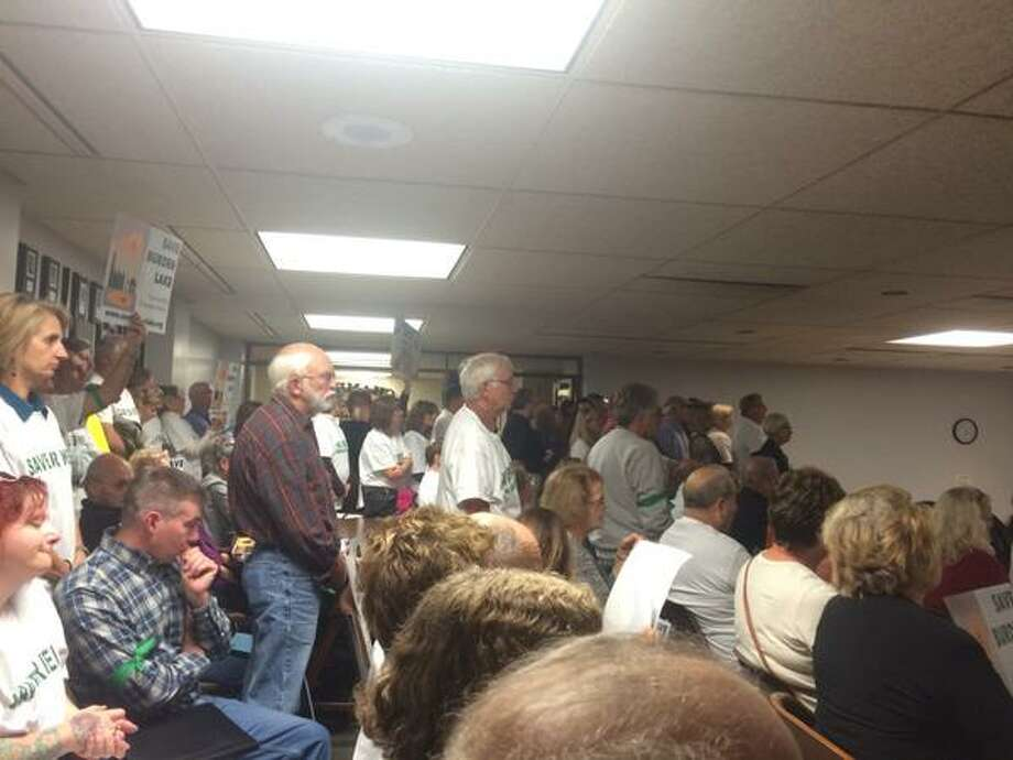 A packed crowd protesting a proposed pipeline and the potential impact on water wells fills the Rensselaer County Legislature's public hearing room Wednesday night, Oct. 7, 2015.  (Lindsay Ellis / Times Union)