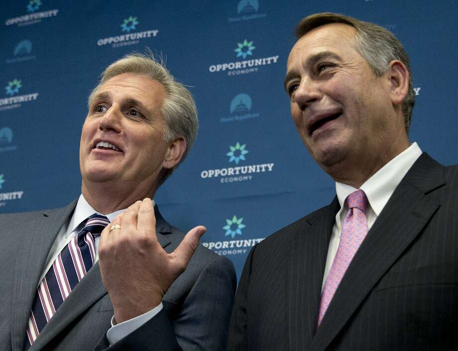 House Majority Leader Kevin McCarthy of Calif. gestures toward outgoing House Speaker John Boehner of Ohio during a new conference on Capitol Hill in Washington, Tuesday, Sept. 29, 2015. McCarthy, who was expected to become Boehner's successor as speaker, took himself out of the running Thursday, Oct. 8, 2015, in face of conservative opposition within GOP ranks. (AP Photo/Carolyn Kaster) Photo: Carolyn Kaster, Associated Press