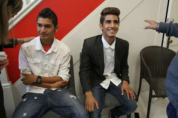 Dennis Escalante (left), 17 years old, and Aseel Mohammad (right), 16 years old, captains on their soccer team, attend a Soccer Without Borders meeting in San Francisco, Calif., on Wednesday, October 7, 2015.  Soccer Without Borders, an east bay non profit hosts a roundtable discussion on how soccer can be a tool to help with the current refugee crisis.
