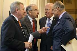 Senate Judiciary Committee Chairman Sen. Charles Grassley, R-Iowa, second from left, talks with Sen. Charles Schumer, D-N.Y., right, and Sen. Patrick Leahy, D-Vt., ranking member on the Senate Judiciary Committee, and Senate Minority Whip Richard Durbin of Ill., left, on Capitol Hill in Washington, Thursday, Oct. 1, 2015, before a news conference to discuss criminal justice reform. A long-awaited bipartisan proposal to cut mandatory prison sentences for nonviolent offenders and promote more early release from federal prisons is scheduled to be disclosed Thursday by an influential group of senators who hope to build on backing from conservatives, progressives and the White House. (AP Photo/Jacquelyn Martin)