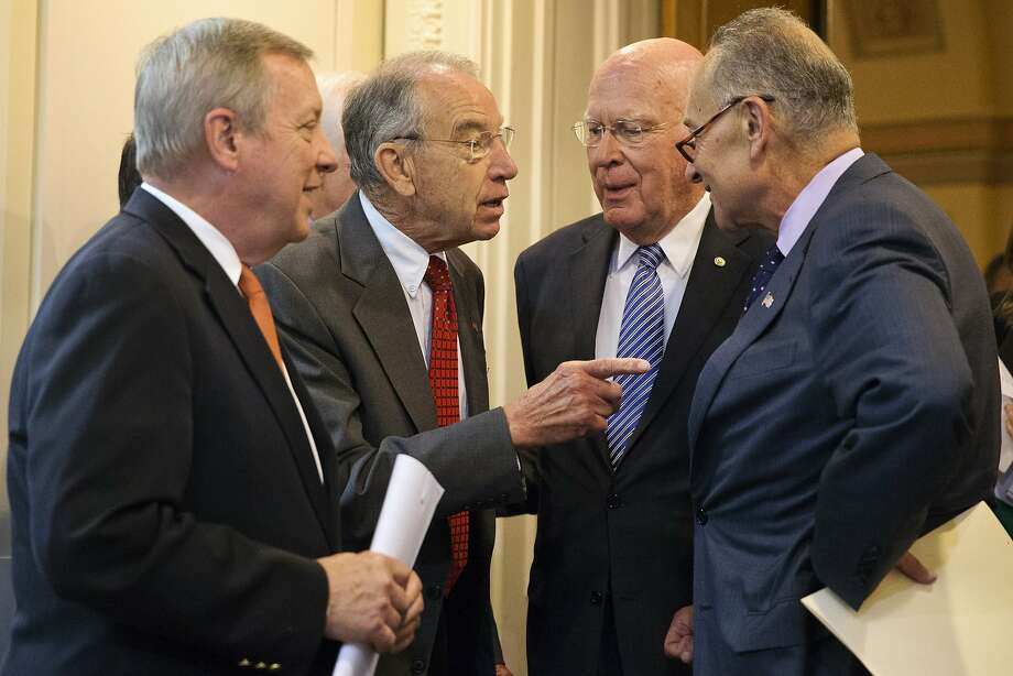 Senate Judiciary Chairman Sen. Charles Grassley, R-Iowa, talks with fellow senators before a recent news conference on criminal justice reform. Photo: Jacquelyn Martin, Associated Press