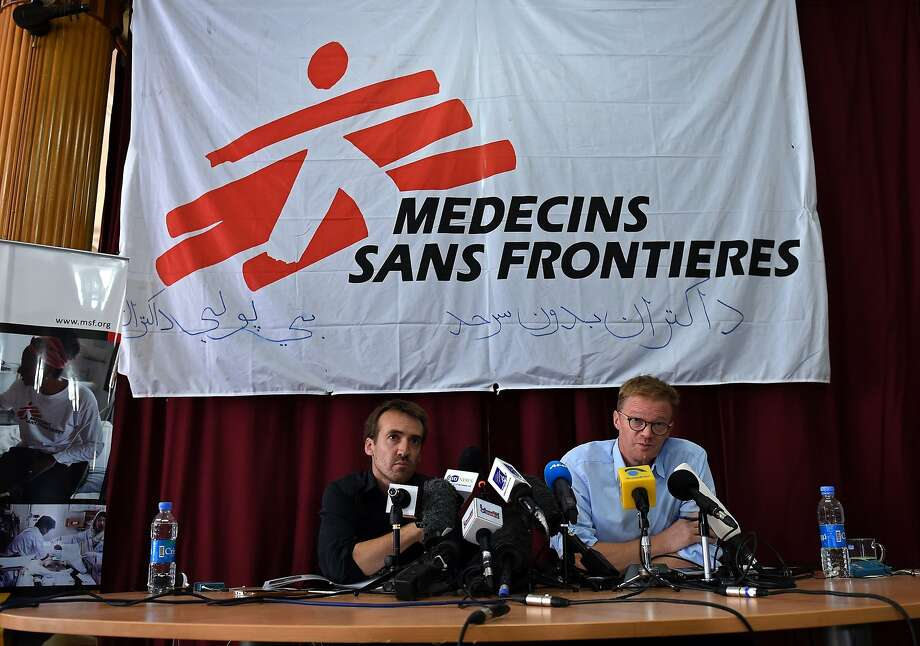 Christopher Stokes (right), Doctors Without Borders executive director, speaks to reporters in Kabul. Photo: Wakil Kohsar, AFP / Getty Images
