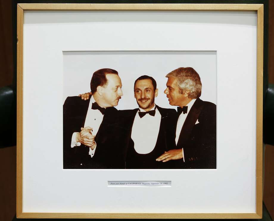 """Wilkes Bashford (left), Michael Bennett, creator of """"A Chorus Line,"""" and Ralph Lauren in a 1982 photo presented to Bashford by California magazine. Bashford keeps the photograph in his office. Photo: Russell Yip, The Chronicle"""