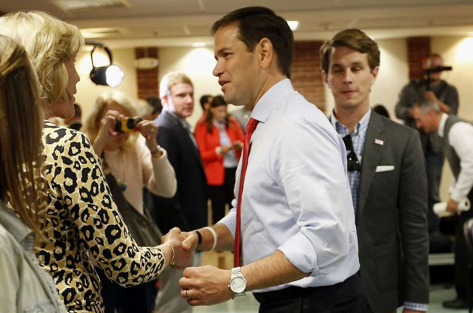 Sen. Marco Rubio greets voters as he arrives for a town hall campaign stop in Dover, N.H. Photo: Jim Cole, Associated Press