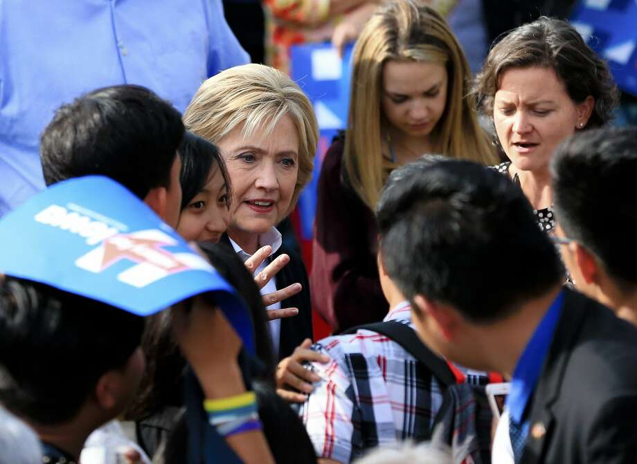 Hillary Rodham Clinton stops to speak to members of the audience at a campaign stop in Council Bluffs, Iowa. Photo: Nati Harnik, Associated Press
