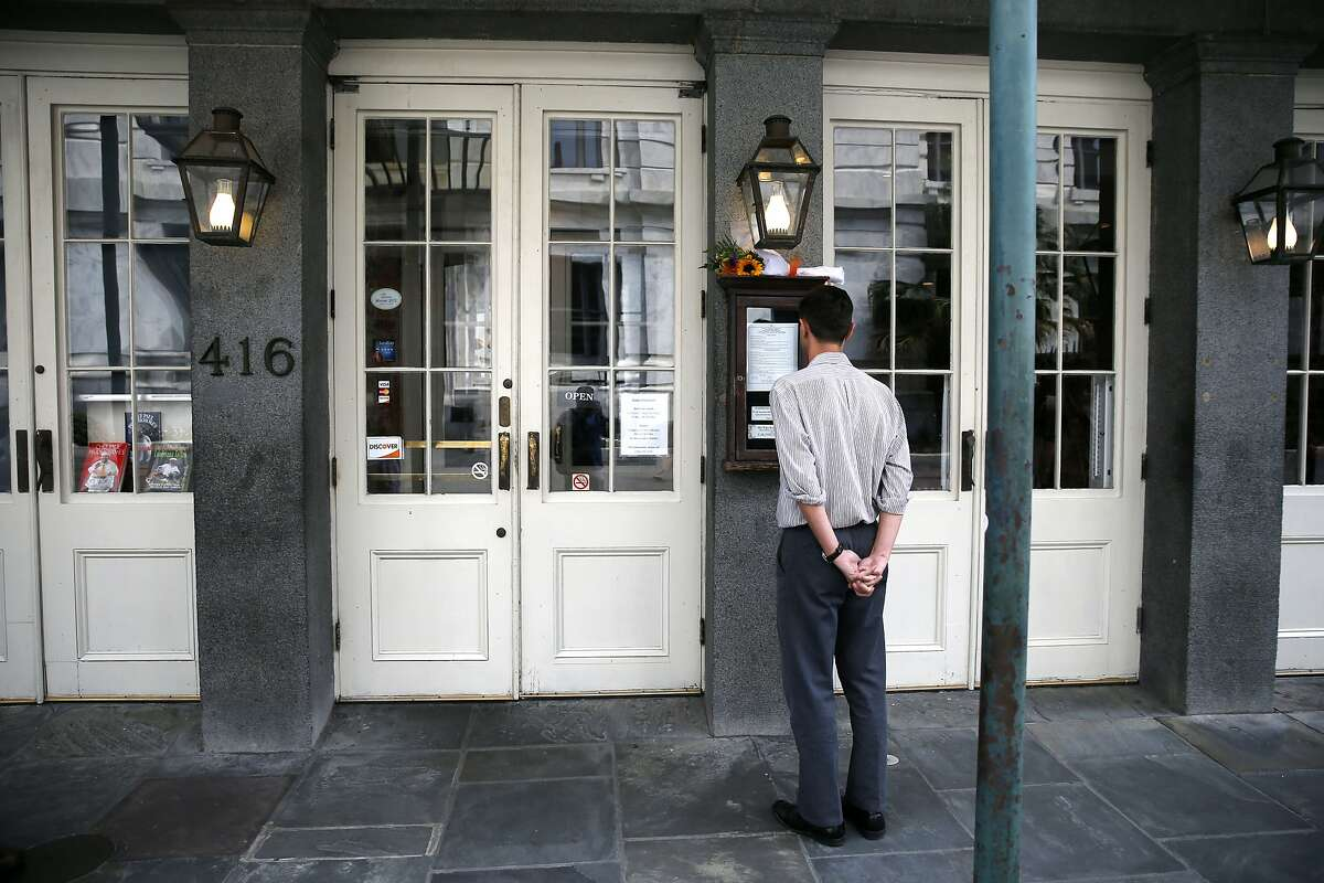 A man looks at the menu outside K-Paul's Louisiana Kitchen in the French Quarter of New Orleans, Thursday, Oct. 8, 2015. The proprietor, famed New Orleans Chef Paul Prudhomme, passed away Thursday. He was 75. (AP Photo/Gerald Herbert)