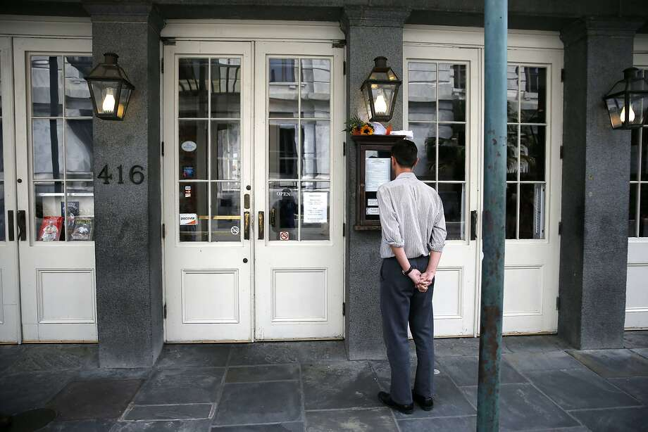 A man looks at the menu outside K-Paul's Louisiana Kitchen in the French Quarter of New Orleans, Thursday, Oct. 8, 2015. Photo: Gerald Herbert, Associated Press