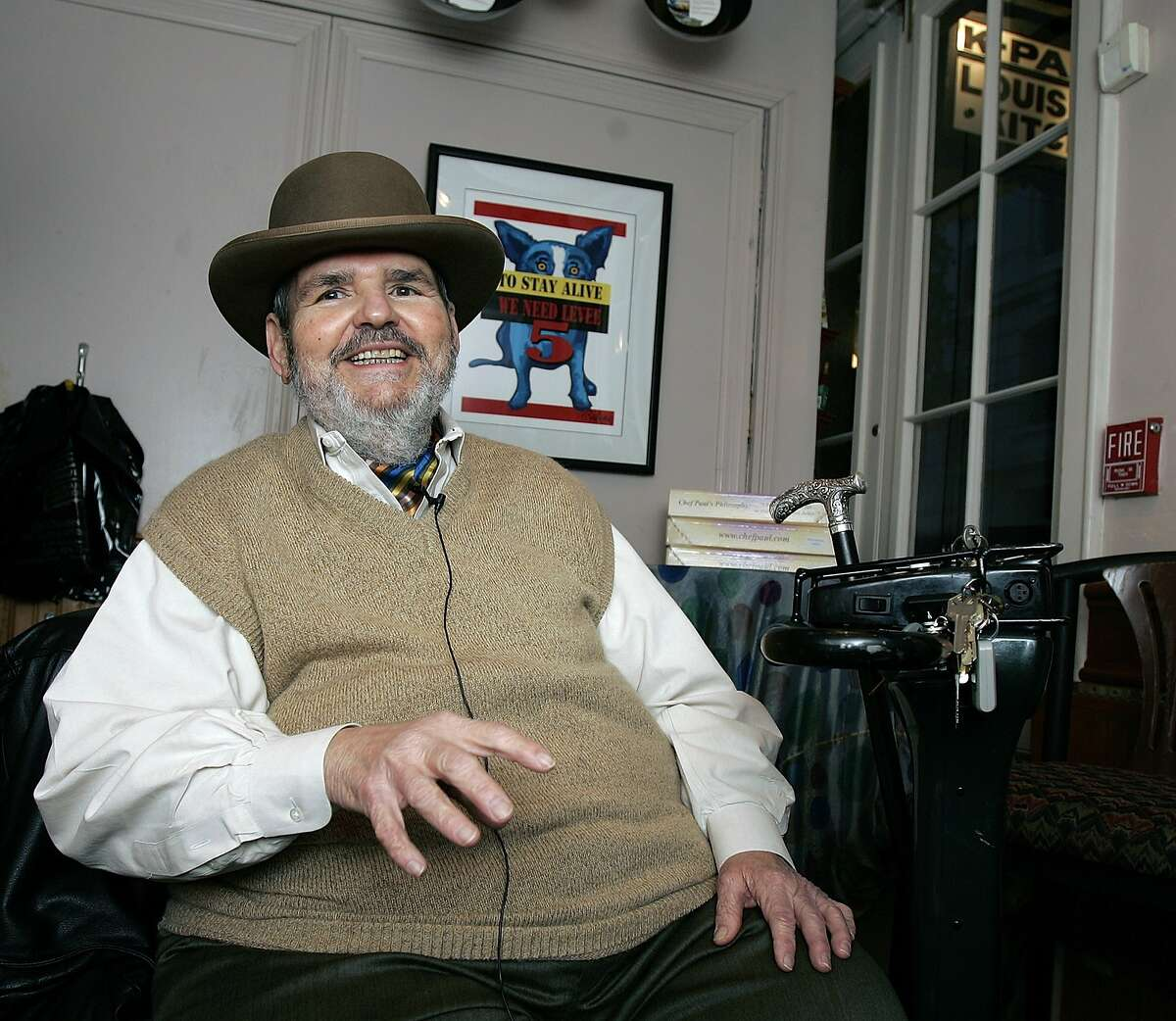 FILE -In this Friday, Feb. 2, 2007 file photo, chef Paul Prudhomme gestures during an interview at his French Quarter restaurant, K-Paul's Louisiana Kitchen, in New Orleans. Prudhomme, the Cajun who popularized spicy Louisiana cuisine and became one of the first American restaurant chefs to achieve worldwide fame, died Thursday, Oct. 7, 2015. He was 75. (AP Photo/Bill Haber, File)