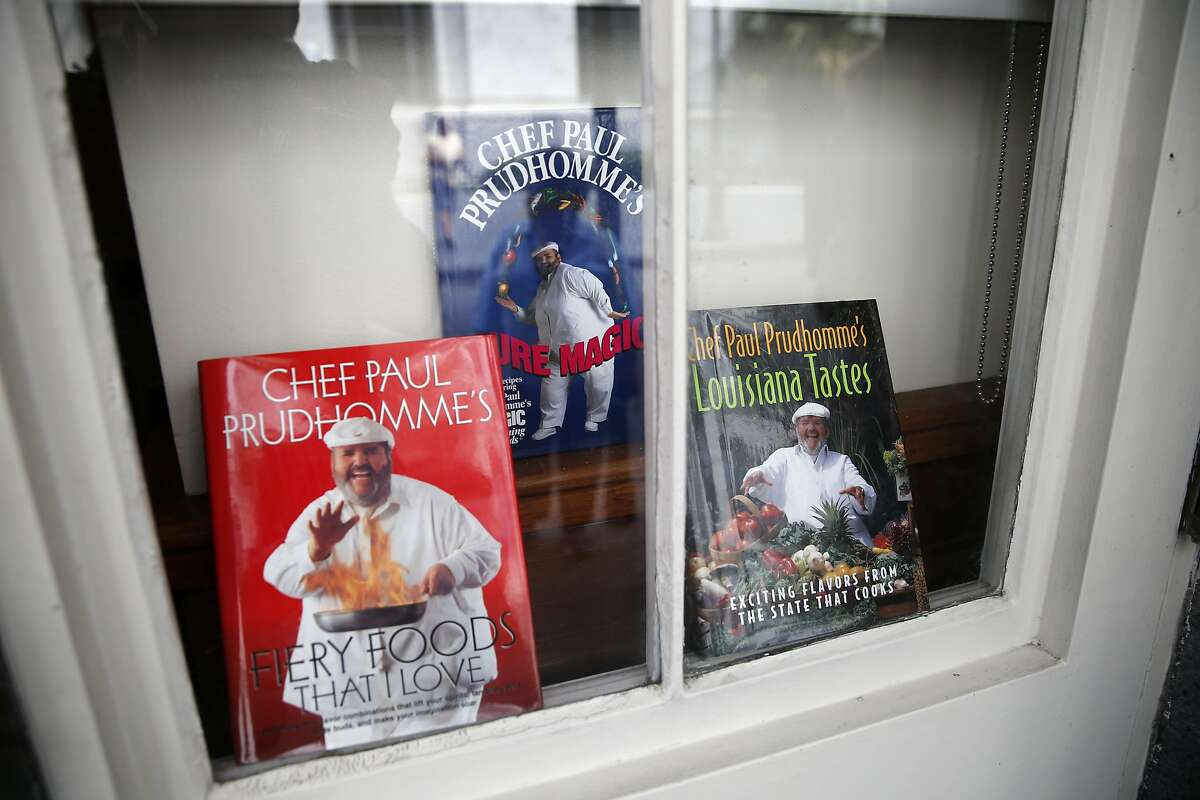Cookbooks by Chef Paul Prudhomme are displayed in a window at K-Paul's Louisiana Kitchen in the French Quarter of New Orleans, Thursday, Oct. 8, 2015. The proprietor, famed New Orleans Chef Paul Prudhomme, passed away Thursday. He was 75. (AP Photo/Gerald Herbert)