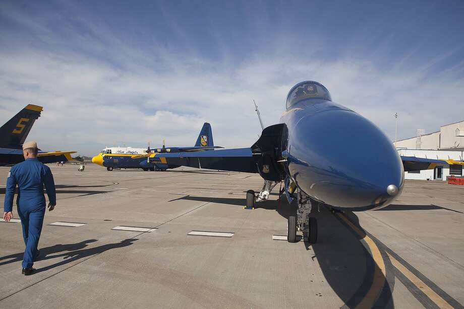 Major Dusty Cook, left, of the Blue Angels walks back to his C-130 on Thursday, October 8, 2015 in preparation for Fleet Week 2015 at the Oakland International Airport. Photo: Brian Feulner, Brian Feulner/ San Francisco Chr