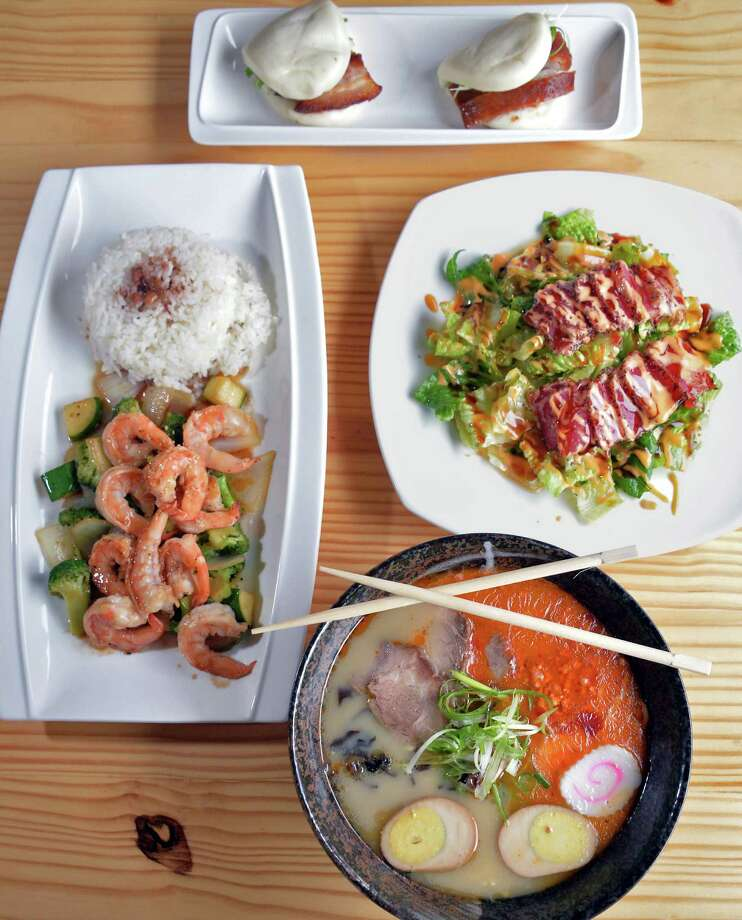 Clockwise from top:  Roast duck and pork belly buns, seared pepper tuna salad, Tanpopo spicy ramen and Teppanyake shrimp at Tanpopo ramen and sake restaurant on Broadway Saturday Oct. 3. 2015 in Albany, NY.  (John Carl D'Annibale / Times Union) Photo: John Carl D'Annibale / 10033614A