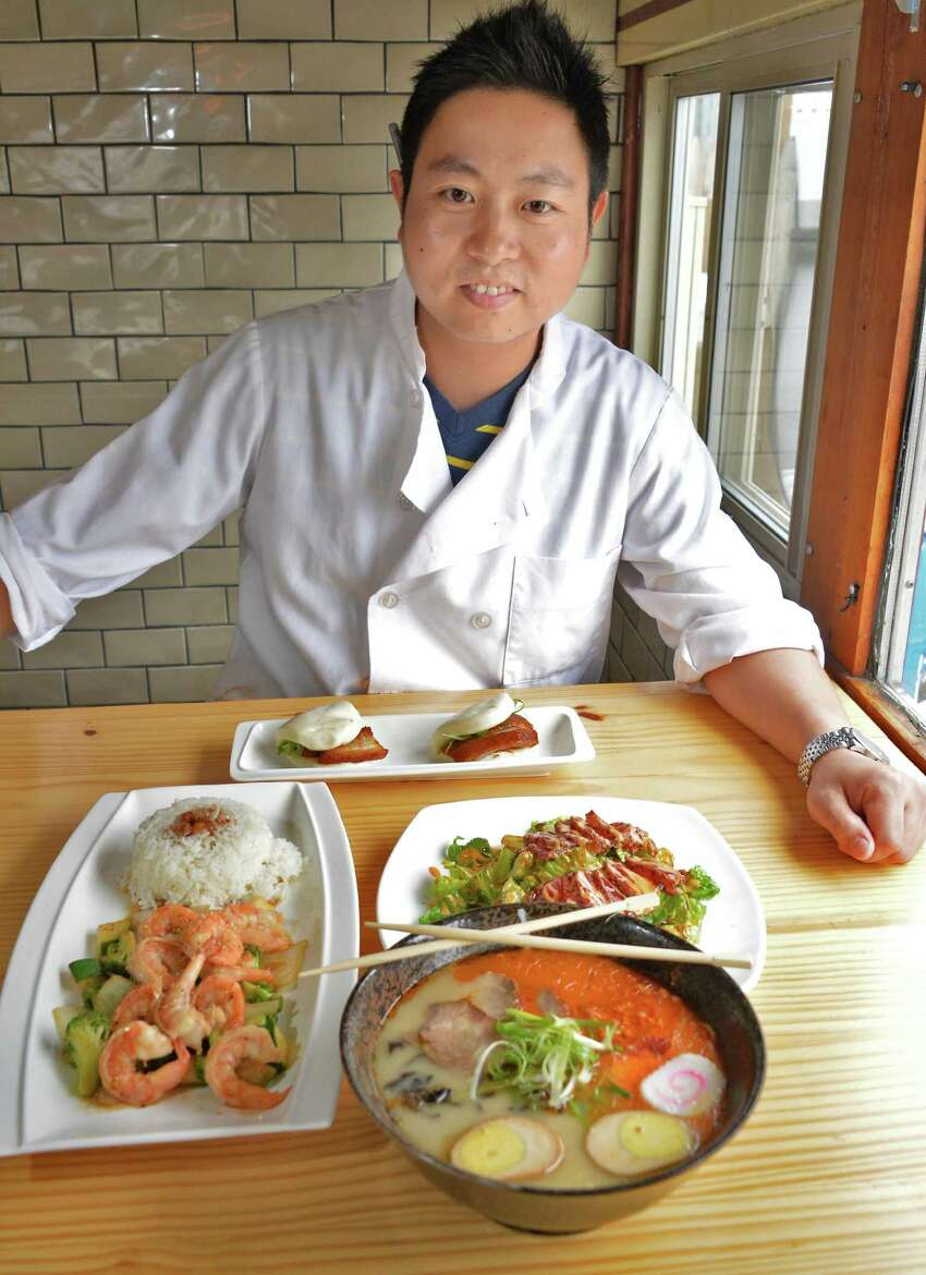 Dave Zehng with a sampling of fare at his Tanpopo ramen and sake restaurant on Broadway Saturday Oct. 3. 2015 in Albany, NY. (John Carl D'Annibale / Times Union)