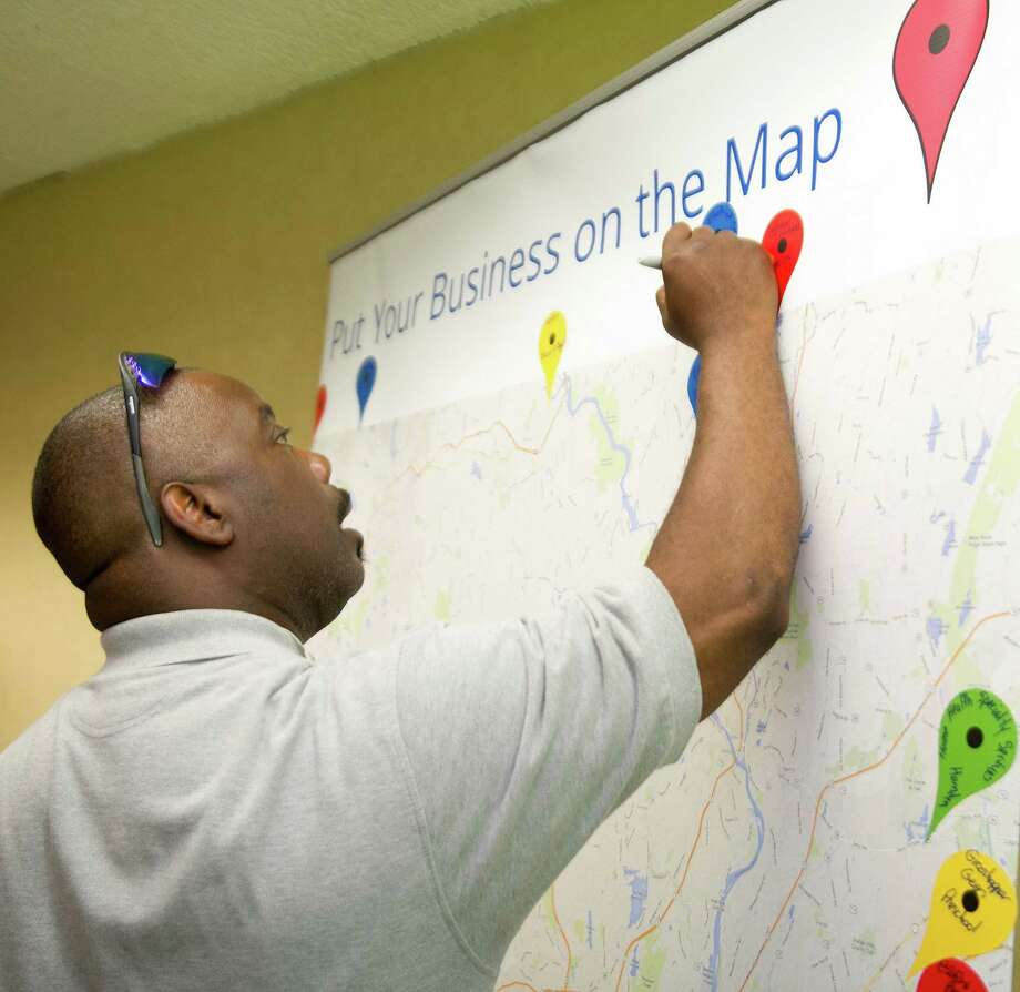 "Charles Federick Sr. puts his business C F Electrical Service on a map during Google's May 2014 ""Get Your Business Online"" event in Norwalk. Photo: Lindsay Perry / Lindsay Perry / Stamford Advocate"