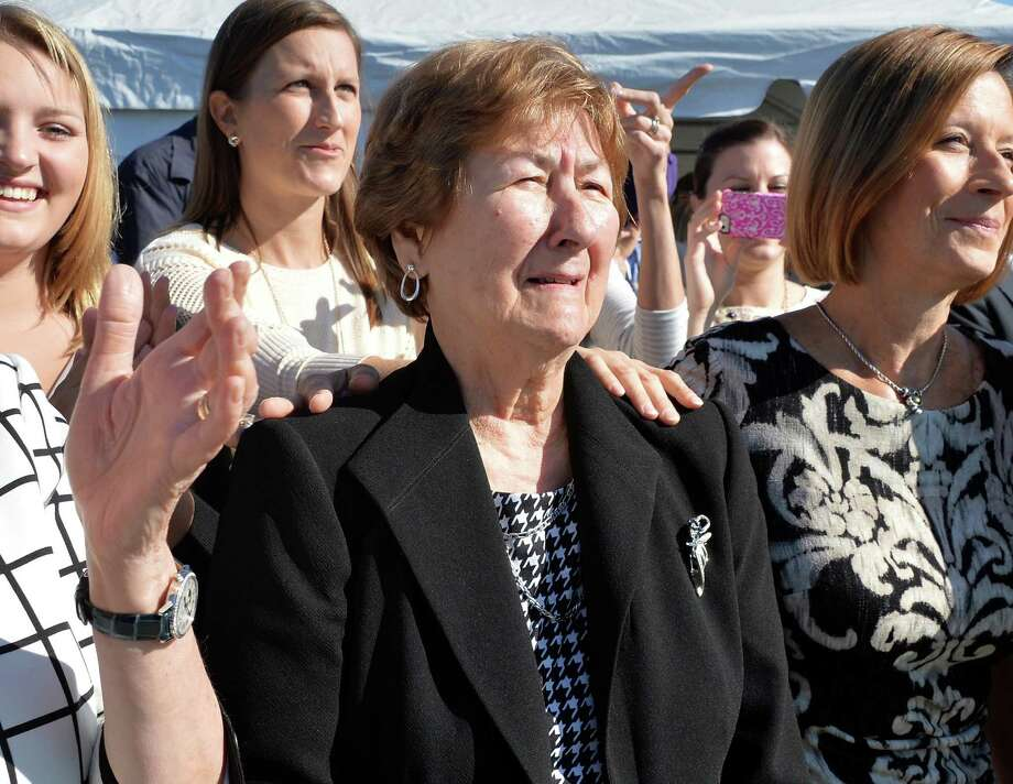 Mary Casey, center, reacts as she watches the unveiling of a new stadium sign naming UAlbany's football stadium the Tom and Mary Casey Stadium during a ceremony Thursday Oct. 8, 2015 in Albany, NY.  (John Carl D'Annibale / Times Union) Photo: John Carl D'Annibale / 10033685A