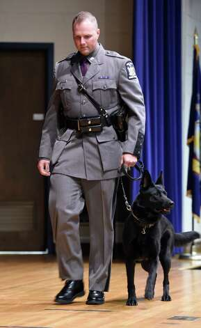 Trooper Jarrod R. Bowman brings Canine L.J. across the stages at the New York State Police Canine Handler Basic School graduation at the State Police Academy Oct. 8, 2015 in Albany, N.Y. Trooper Bowman and L.J. are stationed at the Troop G Northway.     (Skip Dickstein/Times Union) Photo: SKIP DICKSTEIN / 10033669A