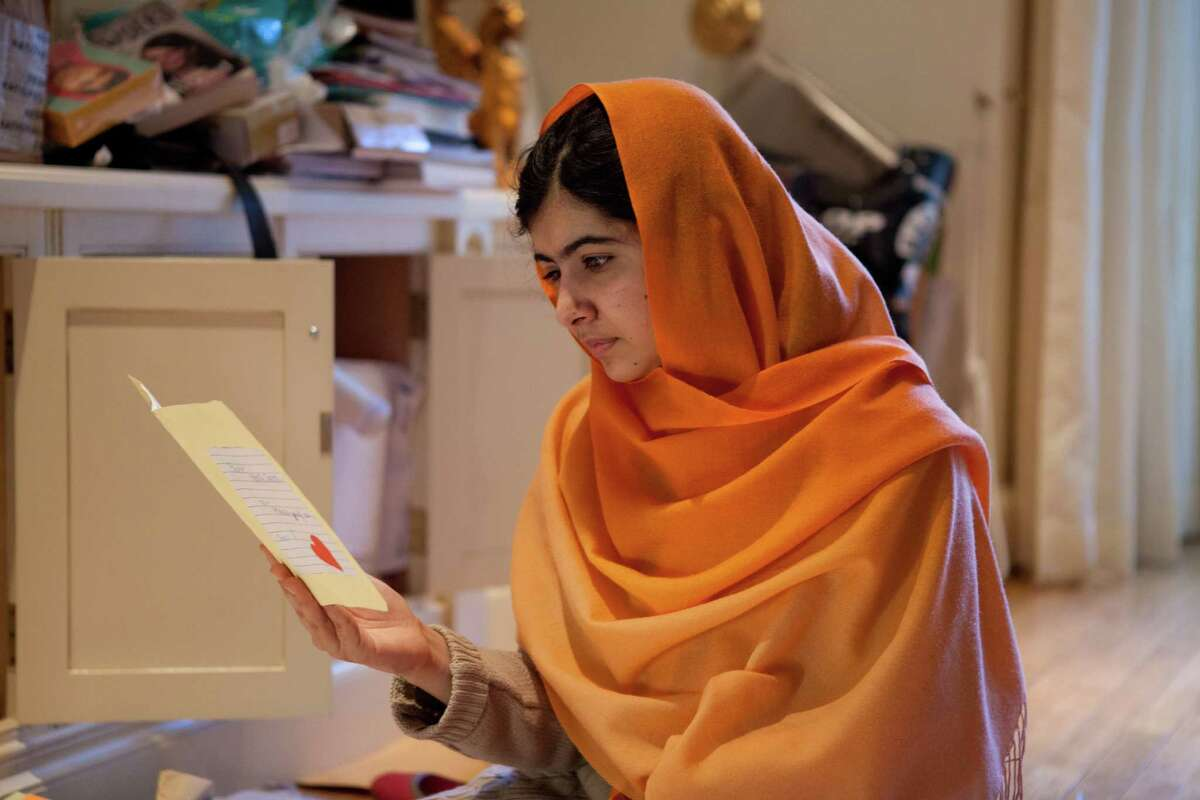 This Dec. 17, 2013 photo provided by Fox Searchlight Pictures shows, Malala Yousafzai in Birmingham, England. Yousafzai is the subject of the documentary film, ?
