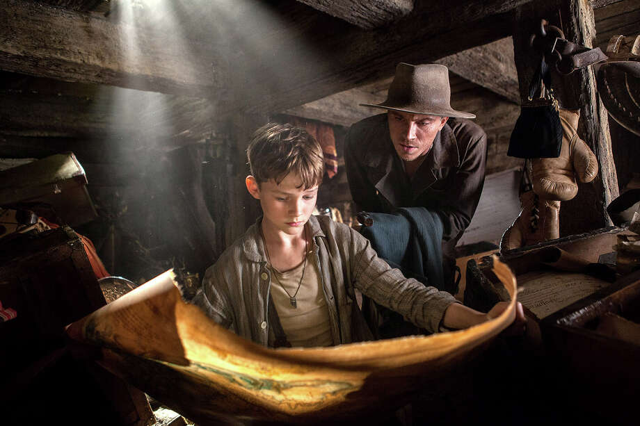 """(L-r) Levi Miller as Peter and Garrett Hedlund as James Hook in """"Pan."""" Illustrates FILM-PAN-ADV09 (category e), by Stephanie Merry © 2015, The Washington Post. Moved Wednesday, Oct. 7, 2015. (MUST CREDIT: Laurie Sparham/Warner Bros. Pictures.) Photo: HANDOUT / THE WASHINGTON POST"""