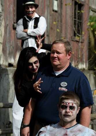 Frank Doninger, operations director surrounds himself with a scary crew that will man an insane asylum at the Great Escape Monday Oct. 5, 2015 in Queensbury, N.Y.  The actors from background to foreground are; Eric Bufford, Kristin Stroebel and Devin Stockman.    (Skip Dickstein/Times Union) Photo: SKIP DICKSTEIN / 10033612A