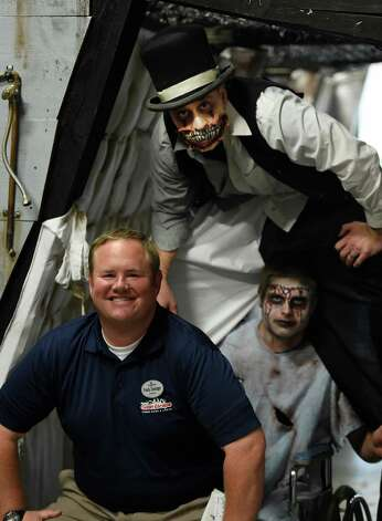 Frank Doninger, operations director surrounds himself with a scary crew that will man an insane asylum at the Great Escape Monday Oct. 5, 2015 in Queensbury, N.Y.  The actors are; Eric Bufford, standing and Devin Stockman.    (Skip Dickstein/Times Union) Photo: SKIP DICKSTEIN / 10033612A