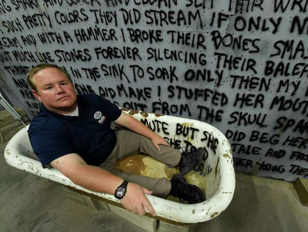 Frank Doninger, operations director finds himself in a tub in an insane asylum set up for show at the Great Escape Monday Oct. 5, 2015 in Queensbury, N.Y.    (Skip Dickstein/Times Union) Photo: SKIP DICKSTEIN / 10033612A