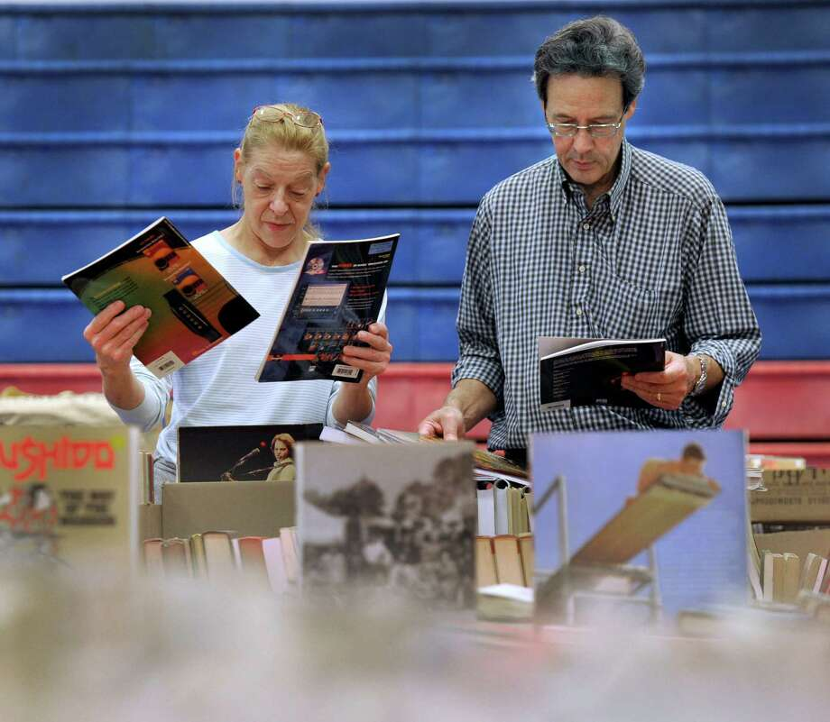 Jill Immermann and Bob Espinosa of Danbury are volunteers working to set up the Friends of the Danbury Library's annual book sale Thursday, Oct. 8, 2015. The book sale is this weekend at the PAL building. Photo: Carol Kaliff / Hearst Connecticut Media / The News-Times