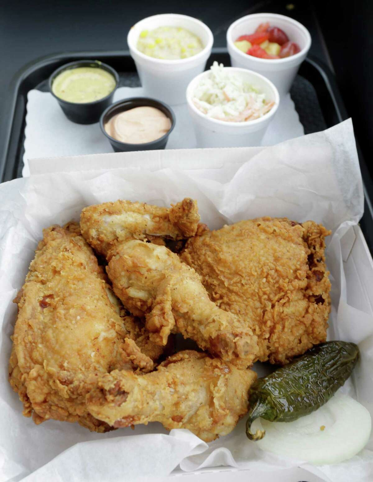 A box of chicken with sides is shown at Lee's Fried Chicken and Donuts, 601 Heights, is shown Thursday, Oct. 8, 2015, in Houston.
