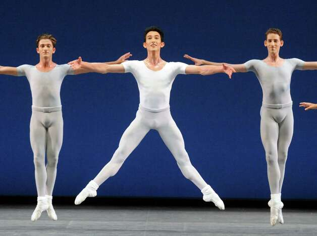 Dancers perform the George Balanchine choreographed Square Dance on opening night of the New York City Ballet at SPAC on Tuesday July 7, 2015, in Saratoga Springs, N.Y.  (Michael P. Farrell/Times Union) Photo: Michael P. Farrell / 00032498A