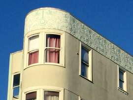 This flatiron building on Market Street near Church Street was builtin 1904 -- but you wouldn't know that by the Art Deco ornamentation below the windows and along the cornice. Even back in 1930, buildings owners would do their best to look up-to-date.