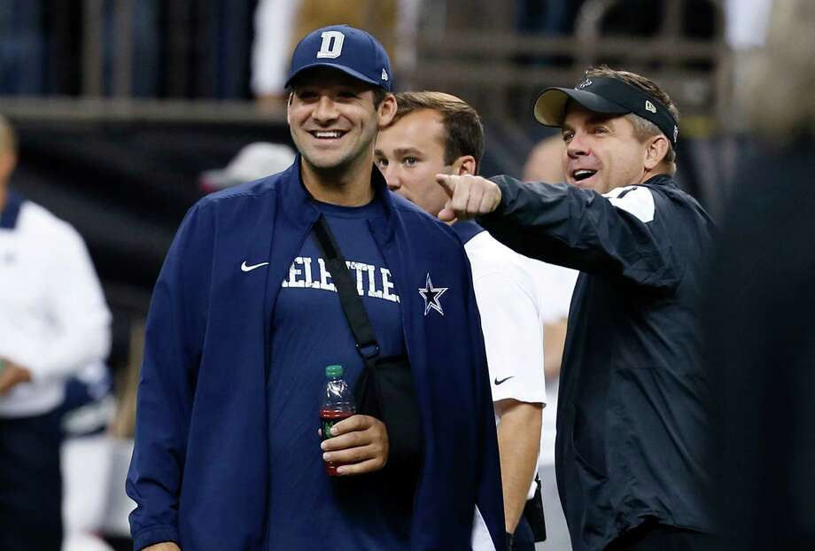 New Orleans Saints head coach Sean Payton talks with Dallas Cowboys quarterback Tony Romo before the game in New Orleans, Sunday, Oct. 4, 2015. Photo: Jonathan Bachman /Associated Press / FR170615 AP