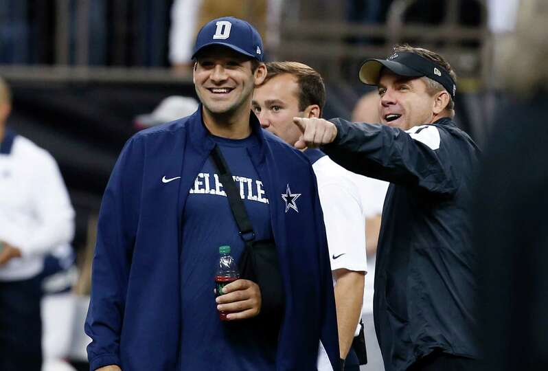 New Orleans Saints head coach Sean Payton talks with Dallas Cowboys quarterback Tony Romo before the